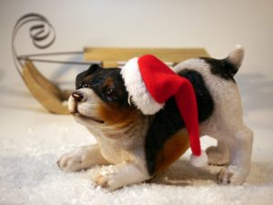 Holiday Pet Precautions - A photo of a puppy in a Santa hat
